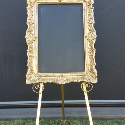 gold blackboard and easel