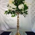 gold pedestal with flower ball